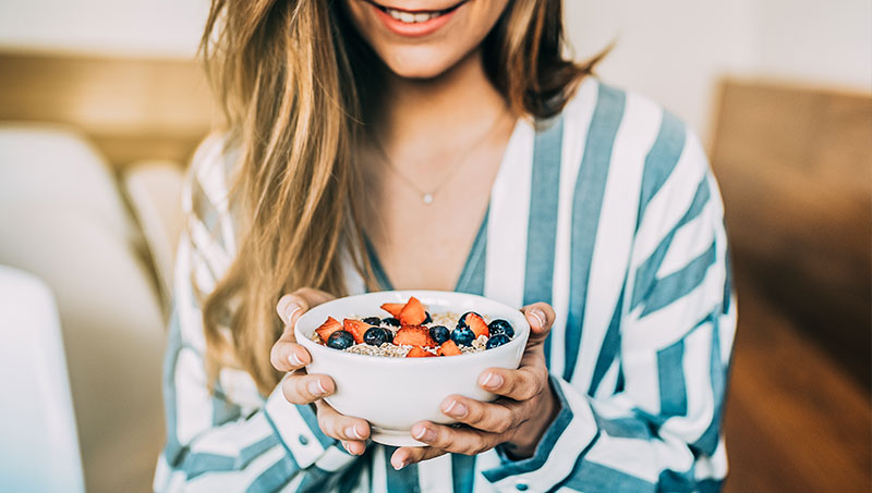Woman eating healthy to build a healthier life