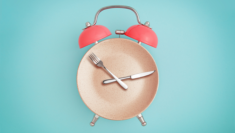 Fasting concept of plate and clock